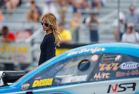 Jun 18, 2016; Bristol, TN, USA; Leeza Diehl, wife of NHRA funny car driver Jeff Diehl during qualifying for the Thunder Valley Nationals at Bristol Dragway. Mandatory Credit: Mark J. Rebilas-USA TODAY Sports
