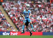 28th May 2018, Wembley Stadium, London, England;  EFL League 2 football, playoff final, Coventry City versus Exeter City; Jordan Shipley of Coventry City heads the ball clear over Jake Taylor of Exeter City