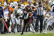 Landover, MD - September 3, 2017: Virginia Tech Hokies running back Steven Peoples (32) gets tackled by West Virginia Mountaineers cornerback Mike Daniels Jr. (4) during game between Virginia Tech and WVA at  FedEx Field in Landover, MD.  (Photo by Elliott Brown/Media Images International)