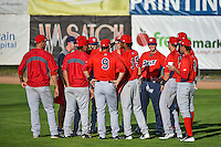 Team members of the Orem Owlz gather in right field before the game against the Ogden Raptors in Pioneer League action at Lindquist Field on August 28, 2015 in Ogden, Utah. Ogden defeated Orem 14-6.  (Stephen Smith/Four Seam Images)