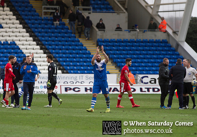 Peterborough United 1 Chesterfield 0, 21/03/2015. Abax Stadium, League One. Home midfielder and goalscorer Michael Bostwick acknowledges the applause at the final whistle at the Abax Stadium, as Peterborough United play Chesterfield in a SkyBet League One fixture. The home team won the match by one goal to nil, watched by a crowd of 6,612. The result allowed Peterborough to leapfrog their opponents into the League One play-off positions with eight games remaining of the season. Photo by Colin McPherson.