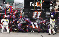 14 September 2008--Denny Hamlin makes a pit stop during the Sylvania 300 at New Hampshire Motor Speedway in Loudon, NH.  (Brian Cleary/BCPix.com)