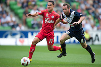 MELBOURNE, AUSTRALIA - JANUARY 09: Iain Ramsay of United and Grant Brebner of the Victory compete for the ball during the round 22 A-League match between the Melbourne Victory and Adelaide United at AAMI Park on January 9, 2011 in Melbourne, Australia. (Photo by Sydney Low / Asterisk Images)