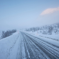 Winter road scene in fog, Senja, Norway