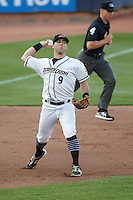 Akron RubberDucks third baseman Joe Sever (9) throws to first base as umpire Chris Graham gets in position during a game against the Richmond Flying Squirrels on July 26, 2016 at Canal Park in Akron, Ohio .  Richmond defeated Akron 10-4.  (Mike Janes/Four Seam Images)