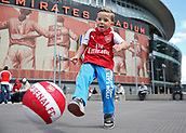 9th September 2017, Emirates Stadium, London, England; EPL Premier League Football, Arsenal versus Bournemouth; 4 year old Callum Brown wearing an Arsenal home shirt kicking an Arsenal ball outside Emirates Stadium before kick off