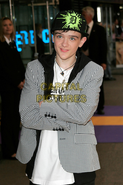 "GEORGE SAMPSON.UK Premiere of ""Hannah Montana: The Movie"" at the Odeon Leicester Square, London, England. .April 23rd 2009 .half length jacket baseball cap hat green fluorescent gingham checked check blazer jacket arms folded crossed black hoodie necklace.CAP/AH.©Adam Houghton/Capital Pictures."