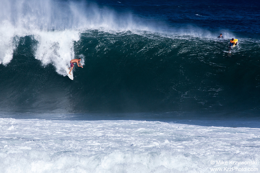 Surfer riding a big wave at Pipeline, North Shore, Oahu
