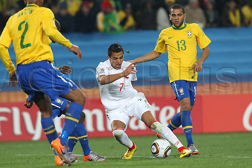 JUNE 28, 2010 - Football : 2010 FIFA World Cup South Africa Round of 16 between Brazil 3-0 Chile at Ellis Park Stadium, Johannesburg, South Africa. Alexis Sanchez (CHI) takes on Maicon in the Brazil defense.