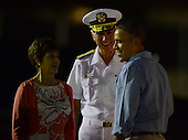 United States President Barack Obama greets U.S. Navy Admiral Samuel Locklear, Commander, U.S. Pacific Command (USPACOM), and his wife Pam Locklear, at Joint Base Pearl Harbor-Hickam in Honolulu, Hawaii on December 20, 2013 as he arrives for the first family's winter vacation.<br /> Credit: Cory Lum / Pool via CNP