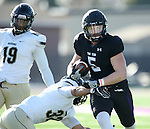 SIOUX FALLS, SD, NOVEMBER 26:  Brady Rose #5 from the University of Sioux Falls slips the grasp of Daylon Markham #32 from Harding University Saturday afternoon at Bob Young Field in Sioux Falls. (Photo by Dave Eggen/Inertia)