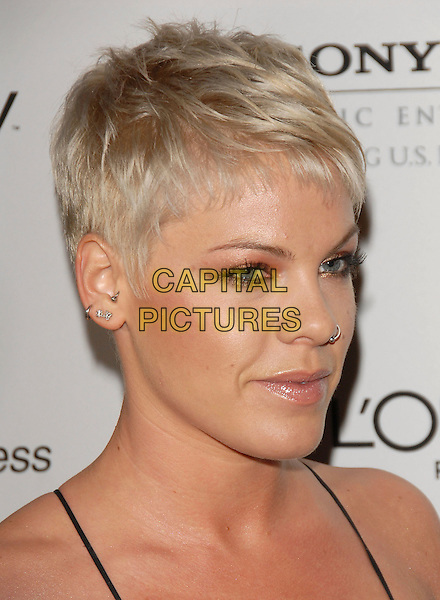 PINK.attends The Clive Davis Pre-Grammy Party .held at The Beverly Hilton Hotel in Beverly Hills, California, USA,  February 10 2007..portrait headshot piink pinnk short bleached blonde hair cropped.CAP/DVS.©Debbie VanStory/Capital Pictures