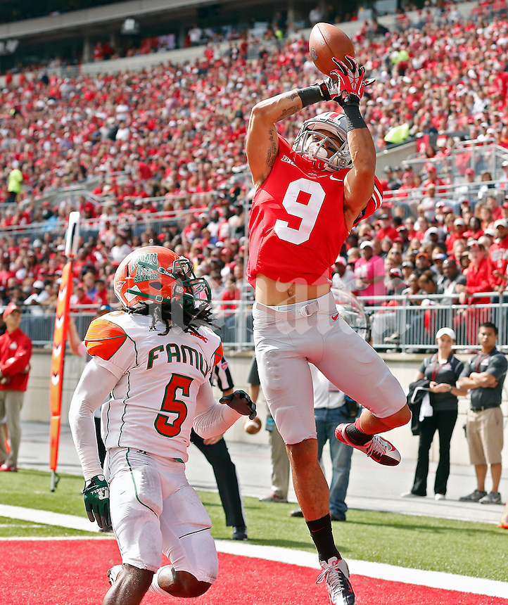 Ohio State Buckeyes wide receiver Devin Smith (9) makes a touchdown catch against Florida A&M Rattlers defensive back Patrick Aiken (5) in the 1st quarter during their college football game at Ohio Stadium on September 21, 2013.  (Dispatch photo by Kyle Robertson)