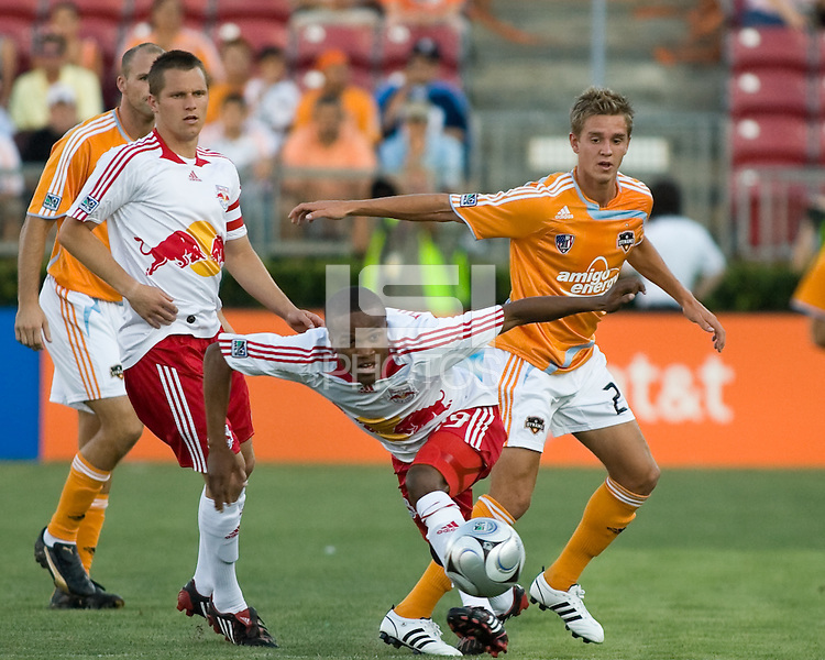 New York Red Bulls midfielder Dane Richards (19)  battles through with the ball as Houston Dynamo midfielder Stuart Holden (22) and New York Red Bulls midfielder Seth Stammler (6) come in from behind.  Houston Dynamo defeated  New York Red Bulls 1-0 at Robertson Stadium in Houston, TX on May 31, 2008.