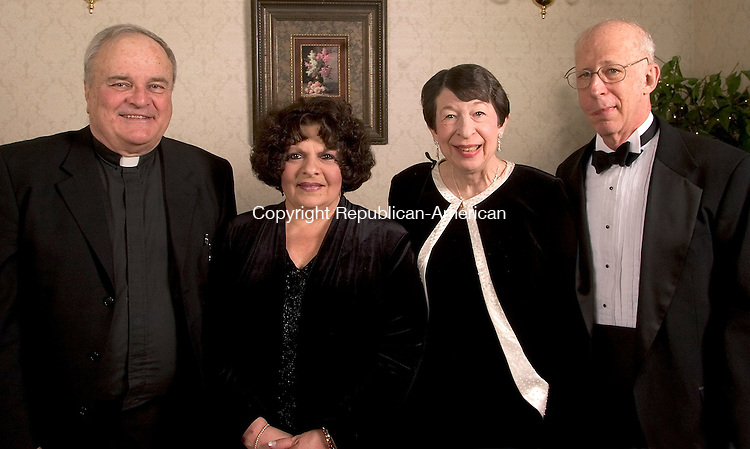 SOUTHINGTON, CT- 05 FEBRUARY 2005-020505JS08--Saint Mary's Health System and Hospital board member Monsignor James G. Coleman of Sts. Peter and Paul Church of Waterbury, 2005 Gala Co-Chair Antoinette Borkowski of Middlebury, and 2005 Gala Co-Chair Judith Sherman and her husband Dr. Joel Sherman of Watertown at the  Saint Mary's Hospital Foundation's 14th annual gala Saturday at the Aqua Turf in Southington. The theme for this year's event was 'Young at Heart' with procedes to benefit Saint Mary's advanced cardiac care program.  -- Jim Shannon Photo--Aqua Turf; Saint Mary's Hospital; Monsignor James G. Coleman, Antoinette Borkowski, Dr. Joel Sherman, Judith Sherman are CQ