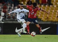 MEDELLÍN- COLOMBIA, 10-05-2018:German Ezequiel Cano (Der.) jugador del Deportivo Independiente Medellín (COL) disputa el balón con Igancio Miño  (Izq.) jugador de Sol de América (PAR) durante partido por la primera ronda ,  etapa 2 de 2 de la Copa Sudamericana  2018 jugado en el estadio Atanasio Girardot de la ciudad de Medellín. / Germna Ezequie Cano (R) player of Deportivo Independiente Medellin (COL) fights for the ball with Ignacio Mino (L) player of Sol de America (PAR) during the match for the Sudamerica Cup  2018 played at the Atanasio Girardot Stadium in Medellin city. Photo: VizzorImage / León Monsalve / Contribuidor
