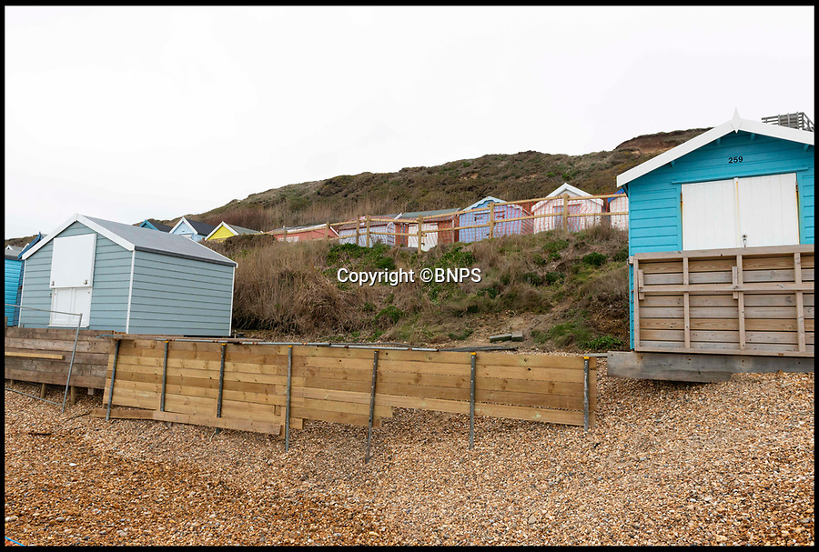 BNPS.co.uk (01202 558833)<br /> Pic:  RogerArbon/BNPS<br /> <br /> The gap where beach huts numbers 260 and 261 once stood, now leaving the ones either side still perched on the edge of the eroding shingle.<br /> <br /> A group of beach hut owners have been evicted from a coastal beauty spot after a local council refused to replenish a shingle bank that washed away.<br /> <br /> Around 20 owners were last week given their marching orders from Hordle Cliff in Hants after coastal erosion left a 12ft drop outside the timber chalets.<br /> <br /> Some rent-payers were given as little seven days notice to vacate the pebble beach, condemning at estimated £1.1m worth of beach huts to destruction.