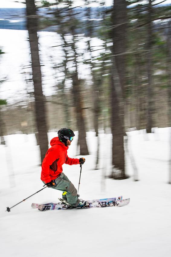 A skier explores the gladed tree skiing at Mount Bohemia on Michigan's Keweenaw Peninsula.