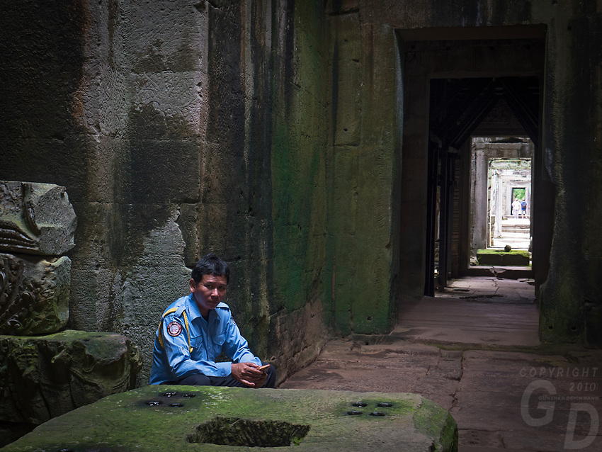 Security Guard in the corridors of Preah Khan, Angkor, Siem Reap, Cambodia