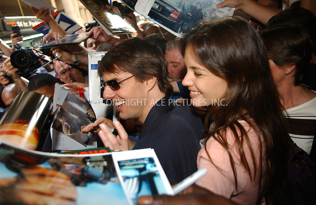 WWW.ACEPIXS.COM . . . . .  ....NEW YORK, JUNE 22, 2005....Tom Cruise and Katie Holmes are seen exiting a 'War of the Worlds' press junkett amidst a mob of fans.....Please byline: Ian Wingfield - ACE PICTURES..... *** ***..Ace Pictures, Inc:  ..Craig Ashby (212) 243-8787..e-mail: picturedesk@acepixs.com..web: http://www.acepixs.com