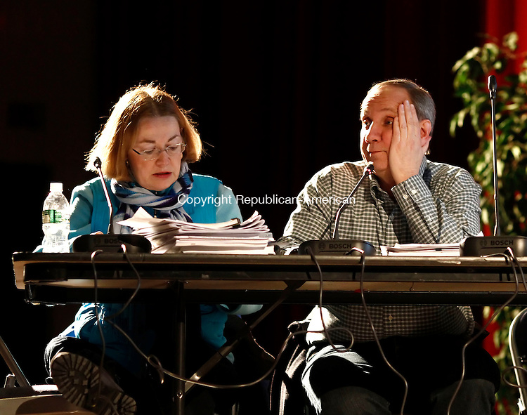 Southbury, CT- 12 February 2014-021214CM01-  Beth A. Barrett, Secretary with the Southbury Zoning Commission, left, and chairman, Gary J. Giroux listen in during a meeting at Pomperaug High School Wednesday night. The town held a public hearing on a proposed movie theater to be built on Main Street in Southbury.  Christopher Massa Republican-American