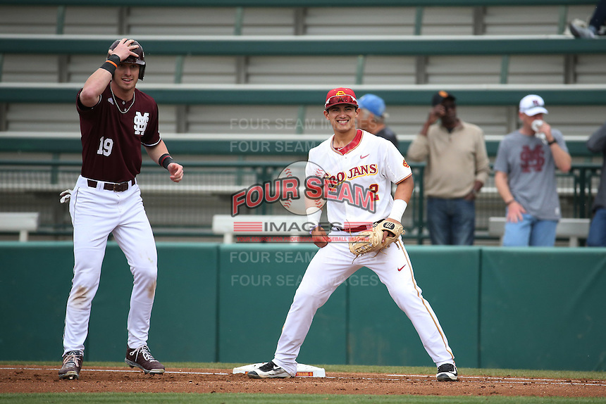 Jeremy Martinez (2) of the Southern California Trojans holds Brent Rooker (19) the Mississippi State Bulldogs on first base during a game at Dedeaux Field on March 5, 2016 in Los Angeles, California. Mississippi State defeated Southern California , 8-7. (Larry Goren/Four Seam Images)