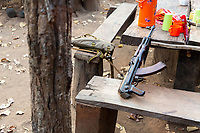 A military policeman's gun at a ranger station in the Phnom Tnout Phnom Pok Wildlife Sanctuary, in northern Cambodia.