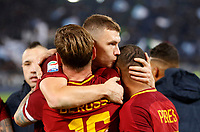 Roma s Daniele De Rossi, left, celebrates with his teammates Edin Dzeko, center, and Bruno Peres at the end of the Italian Serie A football match between Roma and Lazio at Rome's Olympic stadium, 18 November 2017. Roma won 2-1.<br /> UPDATE IMAGES PRESS/Riccardo De Luca