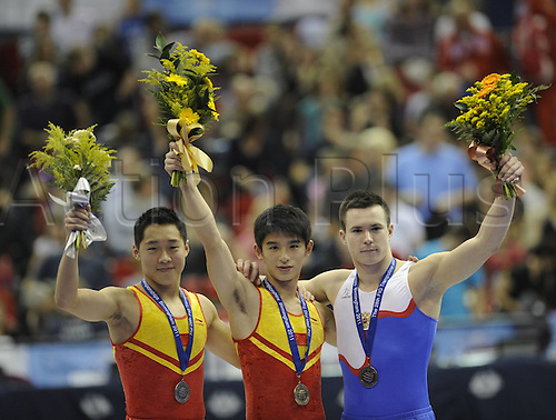 20.11.2011. Birmingham England. Yang Song of China, teammate Zhang Luo and Andrey Krylov of Russia Pose on The winners Podium After the mens Tumbling Individual Final of The 2011 trampoline and Tumbling World Championships in Birmingham Britain Yang Song of China Won with 79,100 Points with His teammates Zhang Luo and Russian Andrey Krylov Ranking Second and Third