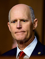 """United States Senator Rick Scott (Republican of Florida) listens to testimony before the US Senate Committee on Armed Services during a hearing on """"Chain of Command's Accountability to Provide Safe Military Housing and Other Building Infrastructure to Service members and Their Families"""" on Capitol Hill in Washington, DC on Thursday, March 7, 2019.<br /> Credit: Ron Sachs / CNP/AdMedia"""