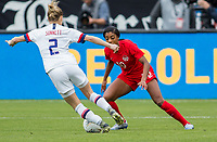 CARSON, CA - FEBRUARY 9: Ashley Lawerance #10 of Canada defending her space from advancing Emily Sonnett #2 of USA during a game between Canada and USWNT at Dignity Health Sports Park on February 9, 2020 in Carson, California.