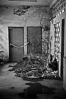 An old bed and debris sits in a corner at the Rajan Babu TB hospital in New Delhi, India.
