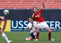 22 MAY 2010:  USA's Stephanie Cox #14 and Germany's Kerstin Garefrekes during the International Friendly soccer match between Germany WNT vs USA WNT at Cleveland Browns Stadium in Cleveland, Ohio. USA defeated Germany 4-0 on May 22, 2010.
