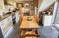 BNPS.co.uk (01202 558833)<br /> Pic: PurpleBricks/BNPS<br /> <br /> Kitchen. <br /> <br /> This £475,000 seaside cottage contains a charming secret – it's built around two Victorian railway carriages.<br /> <br /> The 19th century carriages were used as temporary housing for soldiers returning from the First World War when there was a shortage of homes.<br /> <br /> But many of them remained in place years later and had bricks and mortar built around them.<br /> <br /> And so from the street view they looked like normal houses but inside the main reception rooms were with the converted carriages.