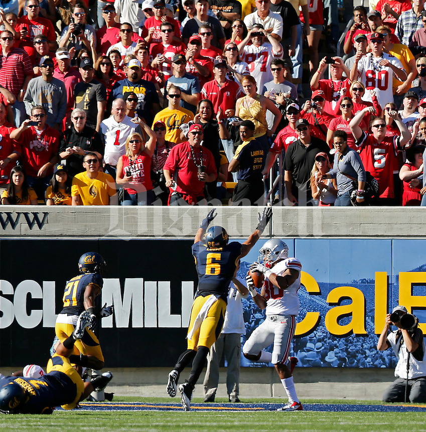 Ohio State Buckeyes wide receiver Chris Fields (80) catches a touchdown pass against California Golden Bears defensive back Alex Logan (6) in the 1st quarter at Memorial Stadium in Berkeley, California on September 14, 2013.  (Dispatch photo by Kyle Robertson)