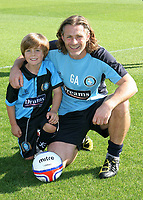 Leo Castledine as a mascot for Wycombe alongside Gareth Ainsworth. Leo is now an England U15 International and recently completed a transfer from AFC Wimbledon to Chelsea. Leo is son of Homes Under the Hammer host Lucy Alexander and former AFC Wimbledon player, Stewart Castledine during Wycombe Wanderers vs AFC Wimbledon, NPower League Two Football at Adams Park on 22nd September 2012