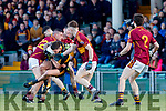 Micheal Burns Dr Crokes in action against Graham Kelly and Enda O'Gorman St Joseph's Miltown Malbay during the AIB Munster GAA Football Senior Club Championship Final match between Dr. Crokes and St. Josephs Miltown Malbay at the Gaelic Grounds in Limerick on Sunday.