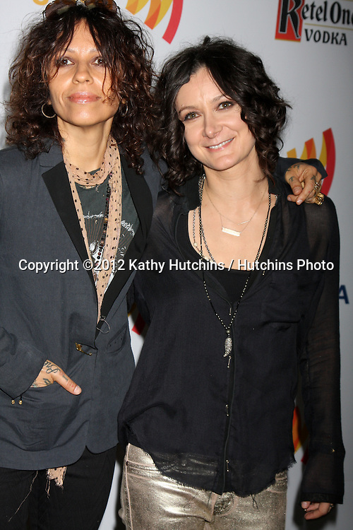 LOS ANGELES - APR 21:  Linda Perry; Sara Gilbert. arrives at the 23rd GLAAD Media Awards at Westin Bonaventure Hotel on April 21, 2012 in Los Angeles, CA