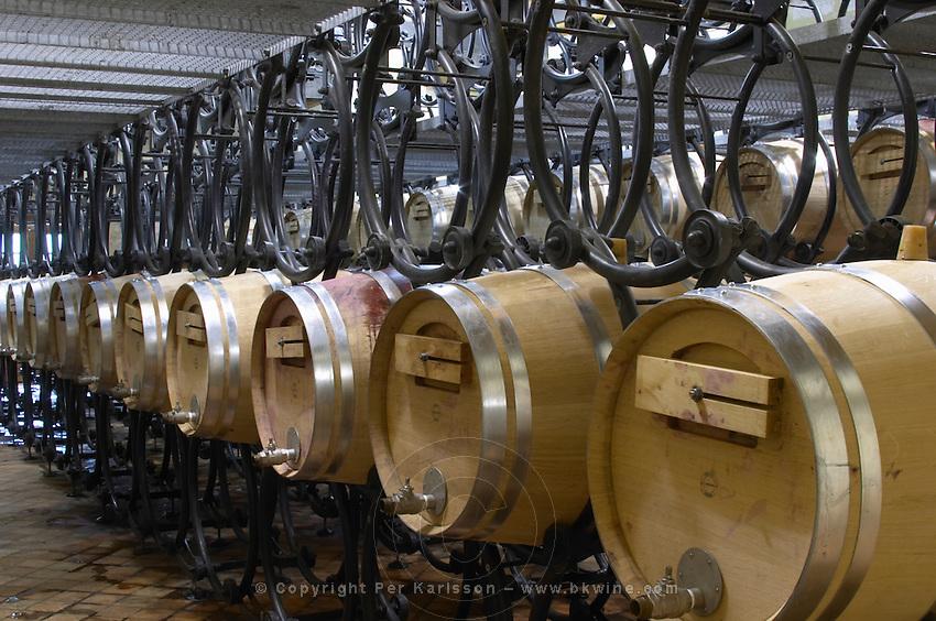 Fermentation in barrel. Oak barrel aging and fermentation cellar. Chateau Reignac, Bordeaux, France
