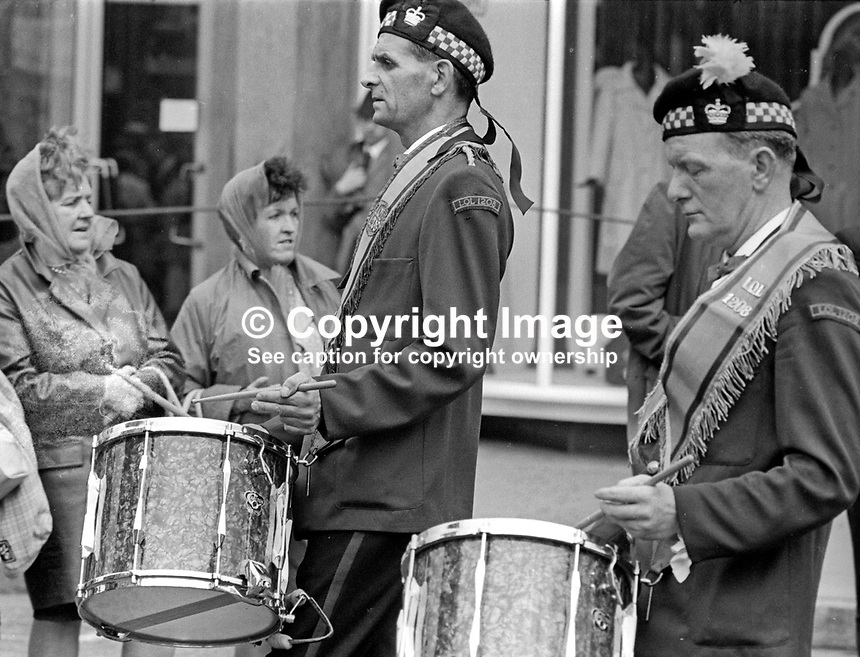 Twelfth of July procession in Belfast, N Ireland, UK, held on Monday 13th July 1970 because the actual Twelfth fell on a Sunday. Bandsmen, drummers, Orangemen, take part in parade. 197007130256h<br /> <br /> Copyright Image from Victor Patterson, 54 Dorchester Park, Belfast, UK, BT9 6RJ<br /> <br /> Tel: +44 28 9066 1296<br /> Mob: +44 7802 353836<br /> Voicemail +44 20 8816 7153<br /> Email: victorpatterson@me.com<br /> Email: victorpatterson@gmail.com<br /> <br /> IMPORTANT: My Terms and Conditions of Business are at www.victorpatterson.com