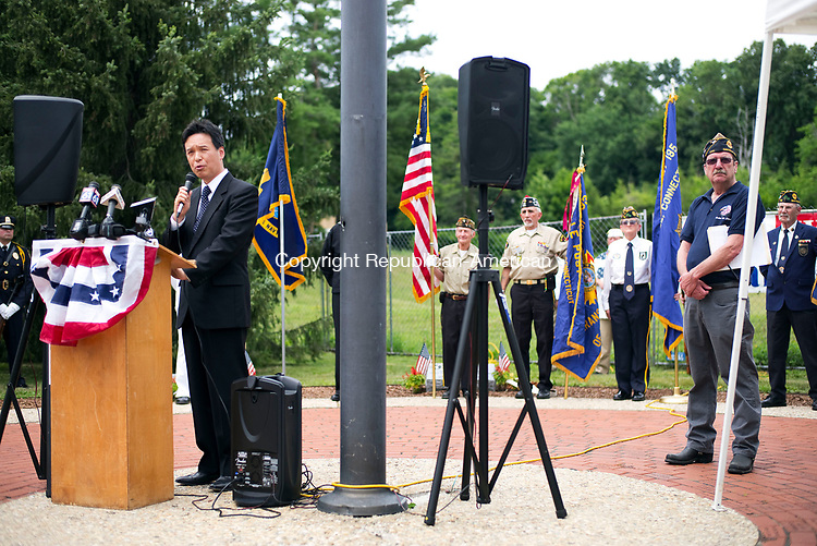 "Watertown, CT- 06 July 2017-070617CM03-  Rokuichiro Michii, consul-general out of the Consulate-General of Japan in Boston, addresses members of the community  during a memorial service on Oakville Green on Thursday.  The Watertown-Oakville Veterans Council held a memorial service for U.S. Navy Sailor Ngoc T. ""Tan"" Truong Huynh was a crew member on the USS Fitzgerald when he was killed after a container ship collided with the destroyer inside Japanese waters.     Christopher Massa Republican-American"