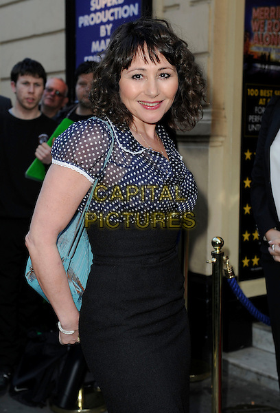 Frances Ruffelle.'Merrily We Roll Along' Press Night at the Harold Pinter Theatre, London, England..May 1st 2013.half length blue polka dot blouse black skirt turquoise bag purse .CAP/GM/PP.©Gary Mitchell/PP/Capital Pictures.