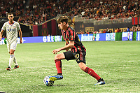 ATLANTA, GA - MARCH 07: ATLANTA, GA - MARCH 07: Atlanta United midfielder Emerson Hyndman dribbles the ball during the match against FC Cincinnati, which Atlanta won, 2-1, in front of a crowd of 69,301 at Mercedes-Benz Stadium during a game between FC Cincinnati and Atlanta United FC at Mercedes-Benz Stadium on March 07, 2020 in Atlanta, Georgia.