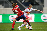 Dax McCarty (11) of the New York Red Bulls is defended by Agustin Pelletieri (8) of Chivas USA. The New York Red Bulls and Chivas USA played to a 1-1 tie during a Major League Soccer (MLS) match at Red Bull Arena in Harrison, NJ, on March 30, 2014.