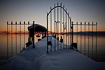 Snow covers a pier on Lake Tahoe in Tahoe Pines, Calif., January 6, 2011. California has already received 80% of its normal annual precipitation in the first two months of a rainy season that lasts another four months.