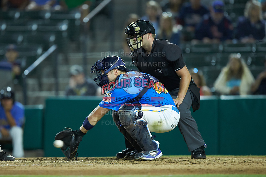 Myrtle Beach Pelicans catcher Tyler Payne (45) receives a pitch as home plate umpire Jake Bruner looks on during the game against the Winston-Salem Dash at TicketReturn.com Field on May 16, 2019 in Myrtle Beach, South Carolina. The Dash defeated the Pelicans 6-0. (Brian Westerholt/Four Seam Images)