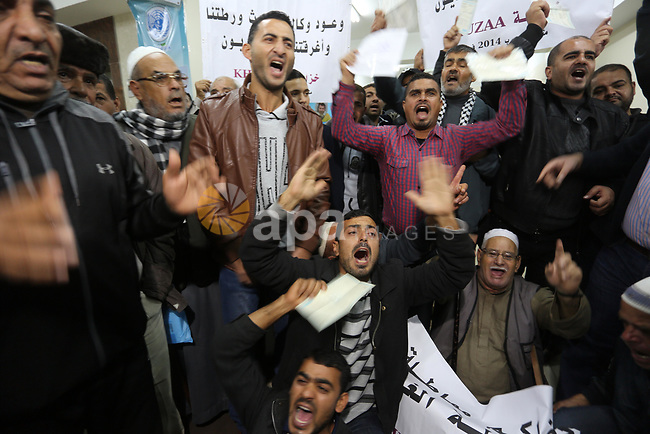 Palestinian owners of houses which were destroyed during the recent Israeli war, take part in a protest demanding repair their houses, at a United Nations-run health center, in Khan Younis in the southern of Gaza strip, December 9, 2019. Photo by Ashraf Amra