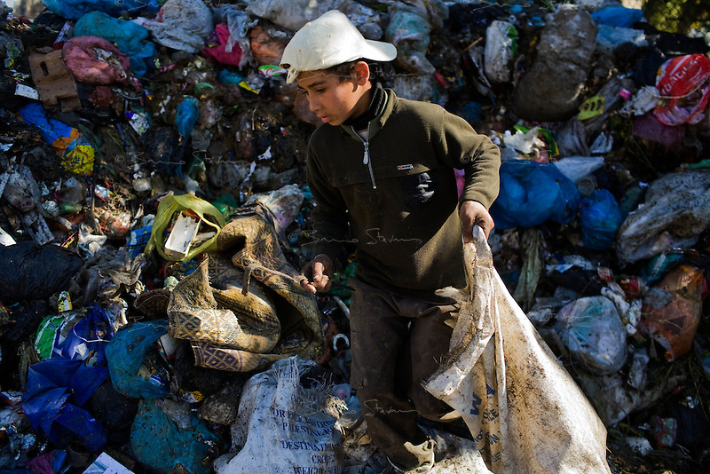 Gaza city, Jan 22 2009.Saher, 10, looks through garbage for anything re-usable....