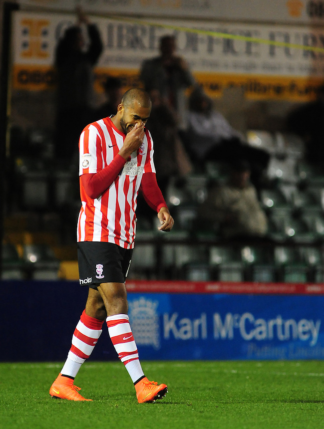 Lincoln City's Delano Sam-Yorke celebrates scoring his sides fourth goal <br /> <br /> Photo by Chris Vaughan/CameraSport<br /> <br /> Football - FA Challenge Cup Fourth Qualifying Round replay - Lincoln City v Alfreton Town - Tuesday 28th October 2014 - Sincil Bank - Lincoln<br /> <br /> &copy; CameraSport - 43 Linden Ave. Countesthorpe. Leicester. England. LE8 5PG - Tel: +44 (0) 116 277 4147 - admin@camerasport.com - www.camerasport.com