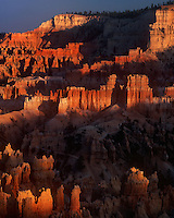 730750038cv2 sunset light turns the hoodoos in the silent city brilliant red and yellow seen from sunset point in bryce canyon national park utah